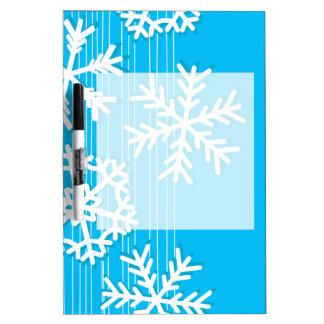 モダンな青およびホワイトクリスマスの白の雪片 ホワイトボード