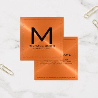 モノグラムのエレガントでモダンなオレンジステンレス製の金属 スクエア名刺