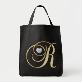 モノグラムの大文字Rの金ゴールドの黒のハートのダイヤモンド トートバッグ