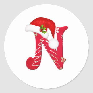 モノグラムの手紙Nのサンタの帽子のクリスマスのステッカー ラウンドシール