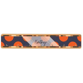 モノグラムの濃紺のオレンジシックな水玉模様パターン キーラック