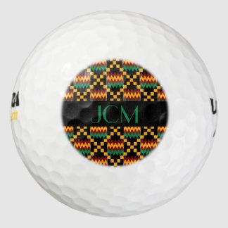 モノグラムの緑、黒、黄色、赤、Kenteの布 ゴルフボール