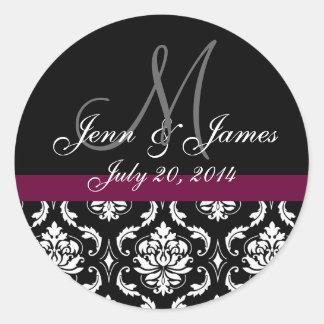 モノグラムは日付のワインのダマスク織の結婚式のシールを示します ラウンドシール