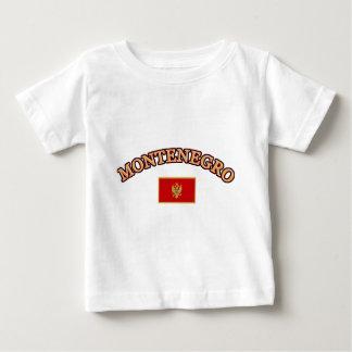 モンテネグロのフットボールのデザイン ベビーTシャツ