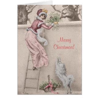 ヤドリギおよび犬のクリスマスのヴィンテージの女の子 カード