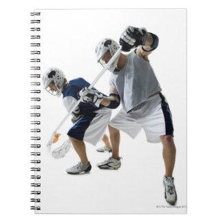 ラクロスを遊んでいる2人の若者 ノートブック
