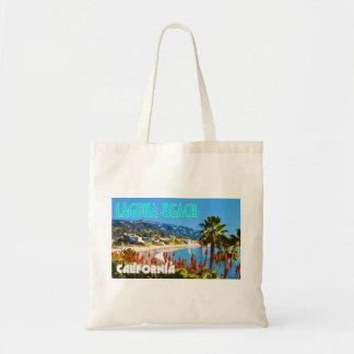 ラグナのビーチのヴィンテージ旅行ポスタースタイル トートバッグ