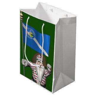 ラスベガスの旗を持つサンタクロース相場師 ミディアムペーパーバッグ