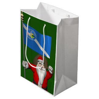 ラスベガスの旗を持つサンタクロース ミディアムペーパーバッグ