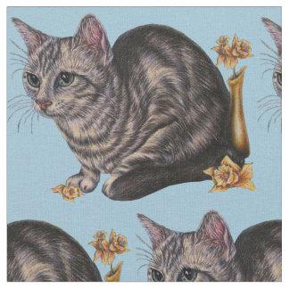 ラッパスイセンの花を持つ猫のスケッチ ファブリック