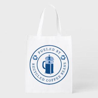 リサイクルされたコーヒー豆の円形のバッジ-青によって燃料を供給される エコバッグ