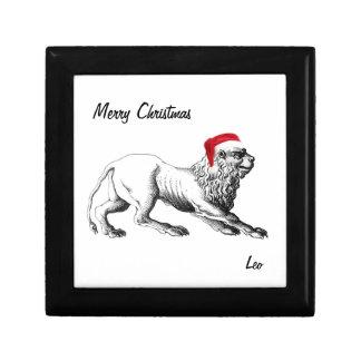 レオは文字が付いているクリスマスのギフト用の箱に蝶番を付けました ギフトボックス