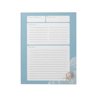 レシピのページの青い砂のドルおよびレース ノートパッド