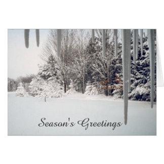 レトロのつららおよび雪で覆われた木のクリスマス カード