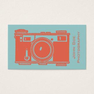 レトロのオレンジヴィンテージのフィルムのカメラの写真撮影 名刺