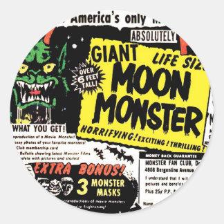レトロのヴィンテージの低俗で巨大な月モンスターの漫画の広告 ラウンドシール