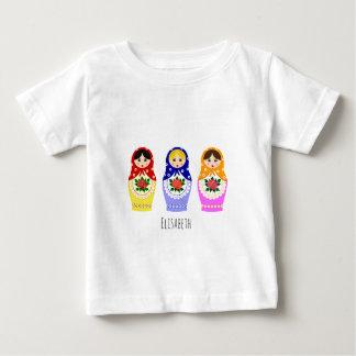 ロシアのなmatryoshkaの人形の一流のベビーのワイシャツ ベビーTシャツ