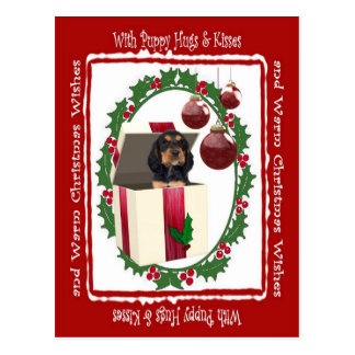 ロットワイラーのクリスマスの子犬は郵便はがき#2を抱き締めます ポストカード