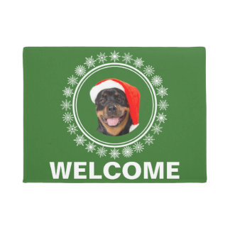 ロットワイラー犬のサンタの雪片のクリスマスの歓迎 ドアマット