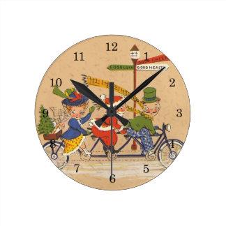 ヴィンテージのクリスマス、バイクのビクトリアンなサンタクロース ラウンド壁時計