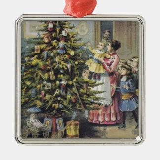 ヴィンテージのクリスマス、木のまわりのビクトリアンな家族 メタルオーナメント