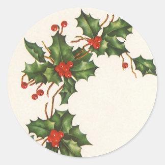 ヴィンテージのクリスマス、赤い果実が付いているヒイラギの植物 ラウンドシール