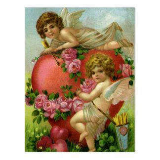ヴィンテージのビクトリアンなバレンタインデーの天使のハートは上がりました ポストカード