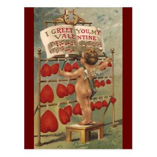 ヴィンテージのビクトリアンなバレンタインデー、キューピッドおよびハート ポストカード