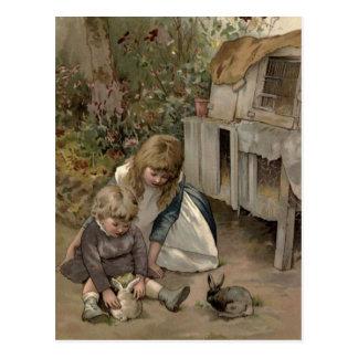 ヴィンテージのビクトリア時代の人及びかわいい: 子供及びバニーウサギ ポストカード