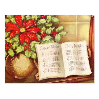 ヴィンテージのピアノ、夜Pointsettiaの静かなクリスマス ポストカード