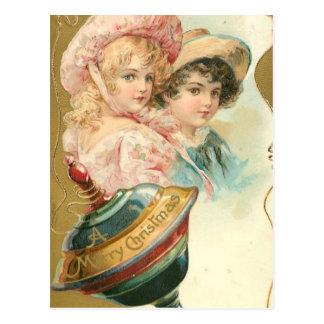 ヴィンテージのメリークリスマスの男の子および女の子 ポストカード