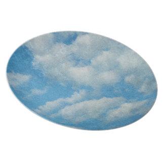 ヴィンテージの動揺してな雲の背景 プレート