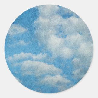 ヴィンテージの動揺してな雲の背景 ラウンドシール