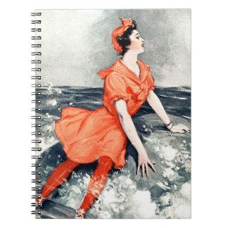 ヴィンテージの女性の石の海の海洋波のオレンジ服 ノートブック
