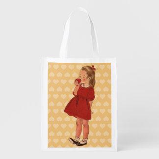 ヴィンテージの小さな女の子の赤い服Apple エコバッグ
