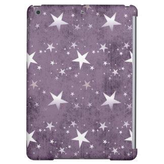 ヴィンテージの紫色の背景の輝くな銀製の星