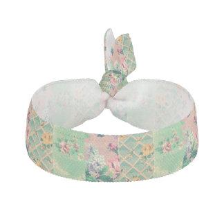 ヴィンテージの花模様の壁紙のヘアタイ ヘアタイ