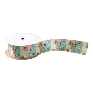ヴィンテージの青く、ピンクの花模様の壁紙のリボン サテンリボン