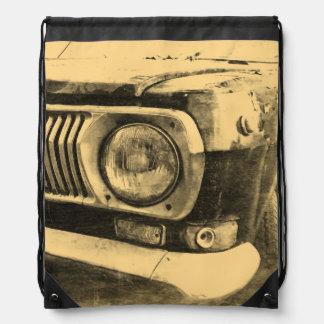 ヴィンテージ古くクラシックな車のヘッドライト ナップサック
