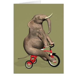 三輪車に乗っているおもしろいな象 グリーティングカード