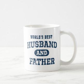 世界で最も最高のな夫および父のエプロン コーヒーマグカップ