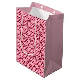 世紀半ばのモダンな原子プリント-バレエのピンク ミディアムペーパーバッグ