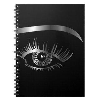 中眉毛および詳細が付いている銀製の目 ノートブック