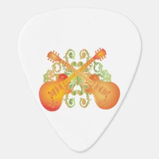 交差するオレンジ日が差すことのギター ギターピック