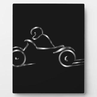 交通安全を示しているバイクもしくは自転車に乗る人 フォトプラーク
