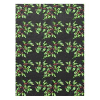 休日のチョークの緑のヒイラギおよび赤い果実の枝 テーブルクロス