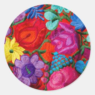 伝統的な刺繍の花柄の織物の詳細 ラウンドシール