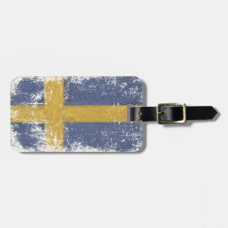 余分汚れた旗が付いている荷物のラベルはfromSweden ラゲッジタグ
