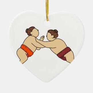 側面のモノラルラインを押しているRikishiの相撲のレスリング選手 セラミックオーナメント