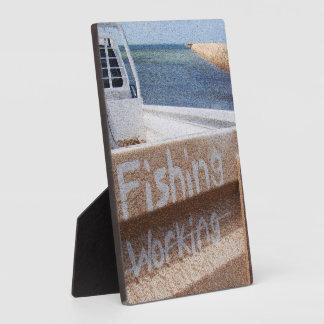 働かないビーチの空の突堤桟橋のユート語の採取 フォトプラーク